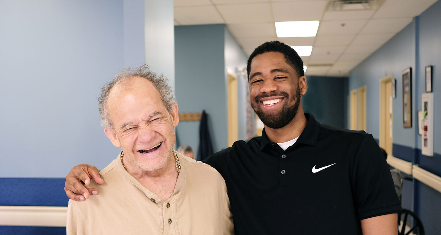 Male rehabilitation patient with male staff member at Sevita program location