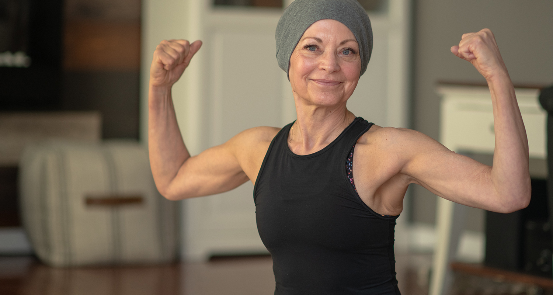 Female rehabilitation patient showing off muscles